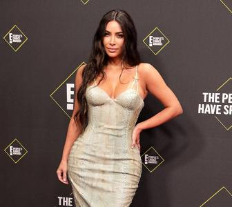 Hot alert! Kim sizzles in a figure-hugging gown