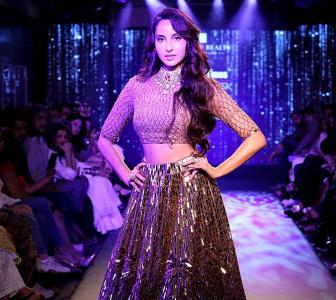 Don't miss! Nora bares midriff in a bronze lehenga