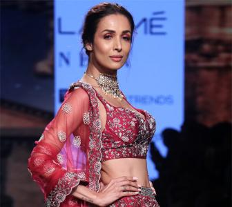 Red hot! Malaika sizzles in a lehenga-choli