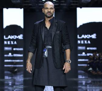 Shikhar Dhawan walks the ramp at Lakme Fashion Week