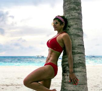 PIX: Mandira Bedi looks RED HOT in a bikini