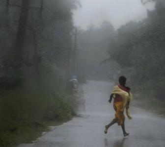 PHOTOS: People flee from the path of Cyclone Phailin