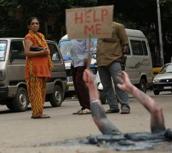 Help! Is this woman drowning in Bengaluru's pothole?