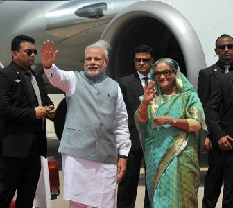 In Dhaka, Hasina breaks protocol, receives Modi at airport