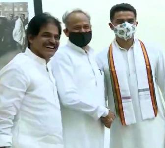 With smile, handshake, Pilot meets Gehlot after truce