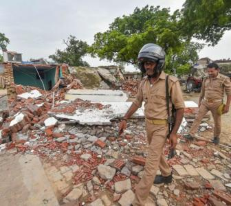 Cops surround Dubey's demolished home; locals keep mum