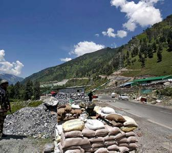 Govt to expedite 32 road projects along China border