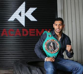 Boxer Amir Khan rolls with the punches