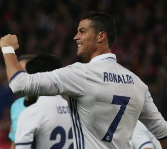 La Liga: Ronaldo treble sinks Atletico, Barcelona held