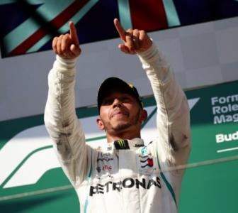 Hamilton wins in Hungary to stretch F1 title lead