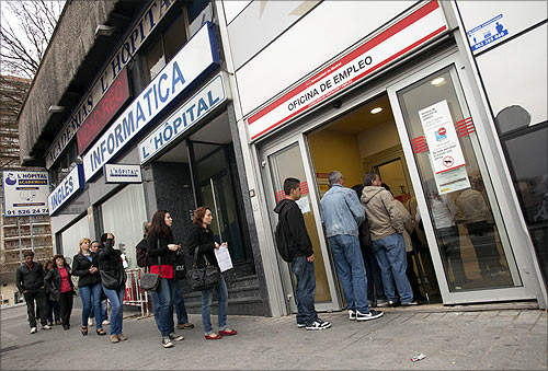 People enter a government employment office in Madrid.