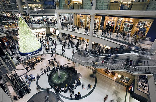 People go shopping in a mall in downtown Toronto.