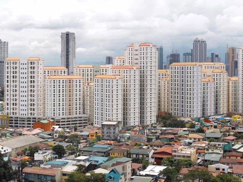 Rows of condominium buildings are seen behind a middle-class residential district in Mandaluyong, Metro Manila.
