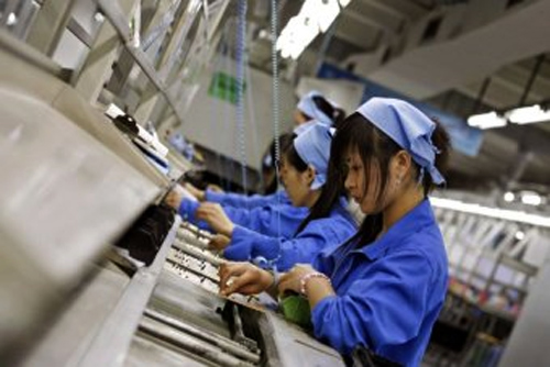 Workers assemble circuit boards at a production line in China's southern city of Shenzhen.