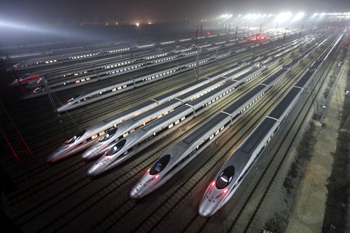 CRH380 (China Railway High-speed) Harmony bullet trains are seen at a high-speed train maintenance base in Wuhan, Hubei province.