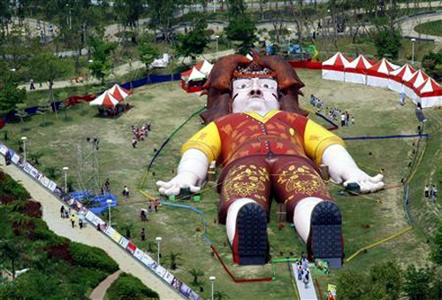 People visit a giant replica of Lemuel Gulliver built in a park in central Taiwan's city of Taichung.
