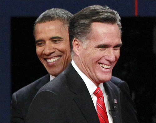 President Barack Obama (L) and Republican presidential nominee Mitt Romney share a laugh at the end of the first presidential debate in Denver.
