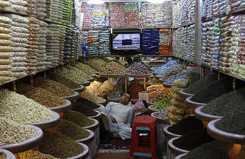 A man sleeps at his shop in Kabul.