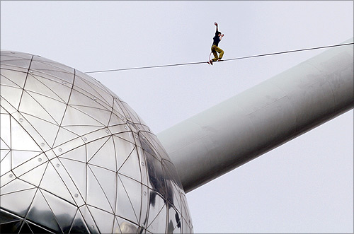 -A tightrope walker practises between two spheres of the Atomium monument in Brussels.