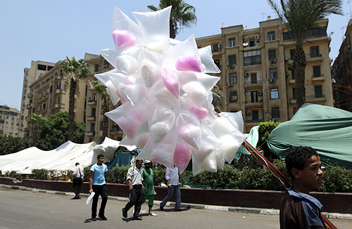 A street vendor sells candy during a sit-in against the military at Tahrir Square in Cairo.