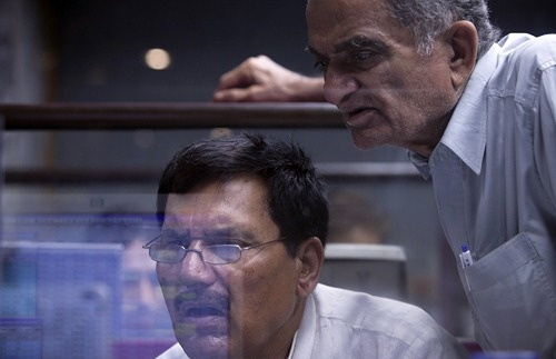 Brokers react as they monitor stock prices at the Karachi Stock Exchange.
