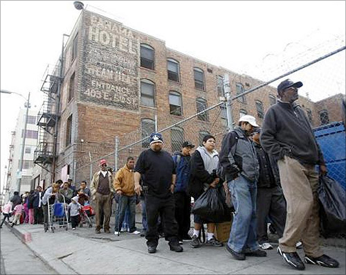 People line up for an early Thanksgiving meal served to the homeless at the Los Angeles Mission in downtown Los Angeles.