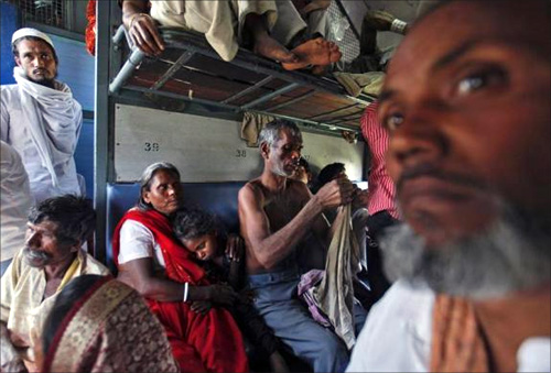Passengers travel inside an overcrowded general class compartment of the Kalka Mail train in Kanpur.