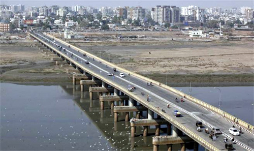 Vehicles move over a bridge built over the river Tapi at Surat, in Gujarat.