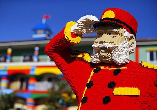 One of hundreds of Lego figures is seen by a pool as construction continues.
