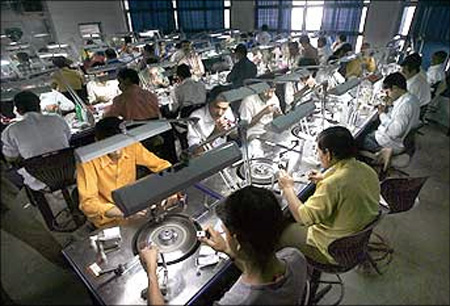 Employees work at a diamond cutting and polishing factory in Surat.