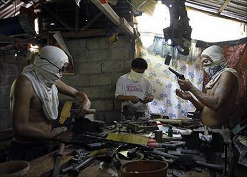 Filipino gunsmiths work in an illegal makeshift gun factory on the outskirts of Danao in central Philippines.