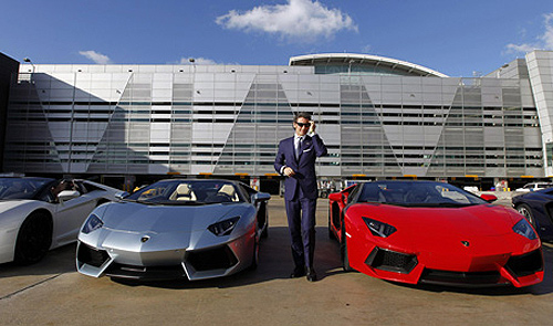 Stephan Winkelmann, President and CEO of Lamborghini, speaks to the media next to Aventador LP 700-4 Roadsters after a high-speed demonstration to mark the automaker's 50th Anniversary at Miami International Airport.