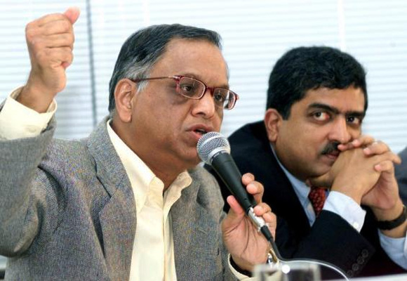 N. R. Narayana Murthy gestures (L) as Nandan Nilekani, looks on in Bangalore 18, 2003.