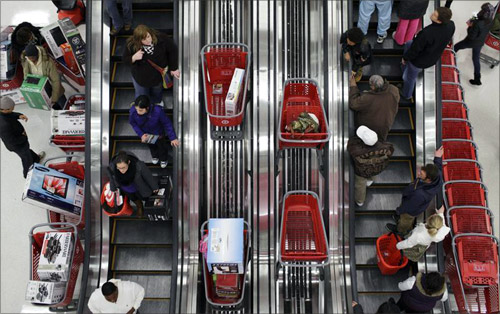 Shoppers ride an escalator at a Target Store in Chicago.