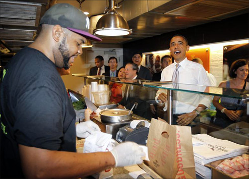 U.S. President Barack Obama orders a hamburger and fries at the Good Stuff Eatery on Capitol Hill in Washington.
