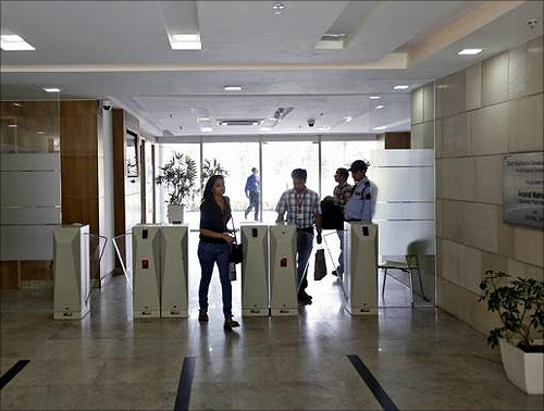 Employees arrive for work at Tech Mahindra office building in Noida on the outskirts of New Delhi.