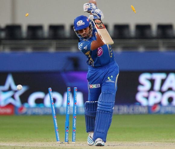 Rohit Sharma is clean bowled by Bhuvneshwar Kumar