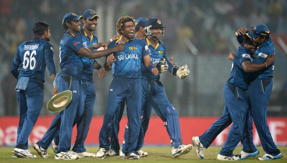 The Sri Lankan players celebrate after winning the game against New Zealand