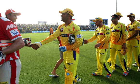 Mahendra Singh Dhoni congratulates the Kings XI players