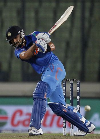 WT20 warm-up: Raina, Kohli guide India to an easy win over England