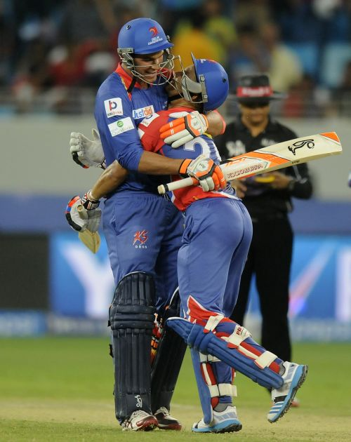 JP Duminy and Nathan Coulter-Nile celebrates after winning the game