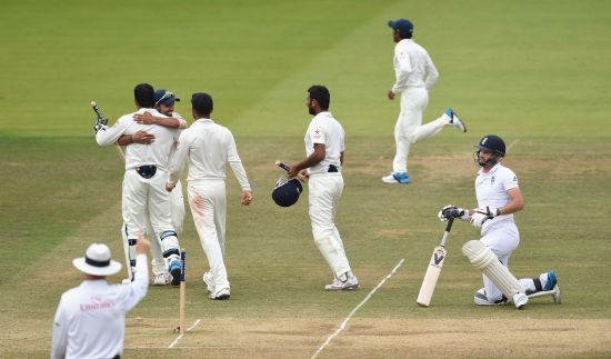 England batsman James Anderson lies stranded as umpire Bruce Oxenford raises the finger, and India players celebrate winning the Lord's Test