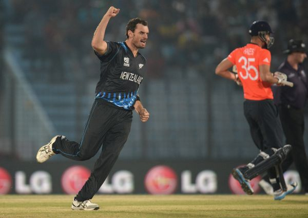Kyle Mills of New Zealand celebrates dismissing Alex Hales of England