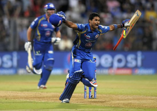 Aditya Tare celebrates after winning the game for Mumbai Indians.
