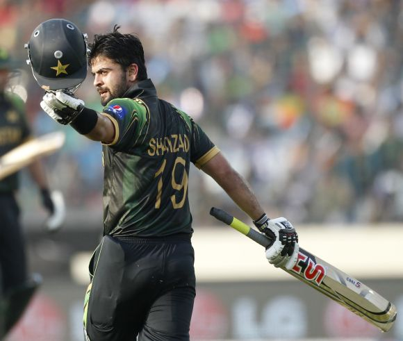 Ahmed Shehzad celebrates after reaching his century