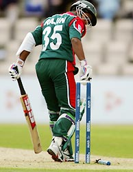 Bangladesh captain Rajin Saleh is bowled by Mervyn Dillon