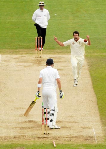 Australia's Ben Hilfenhaus celebrates after bowling England's Pietersen during the first Ashes Test in Cardiff