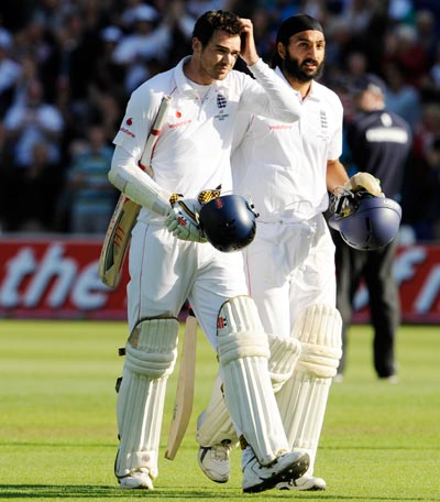 England's James Anderson (left) and Monty Panesar leave the field after securing a draw in the first Ashes Test against Australia at Cardiff