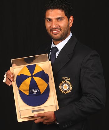 Yuvraj Singh poses with his cap as a member of The ODI Team of the Year