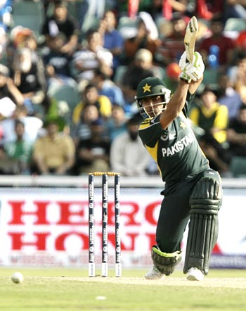 Umar Akmal drives the ball during his innings of 55